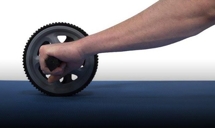 Ab wheel being used on a blue mat