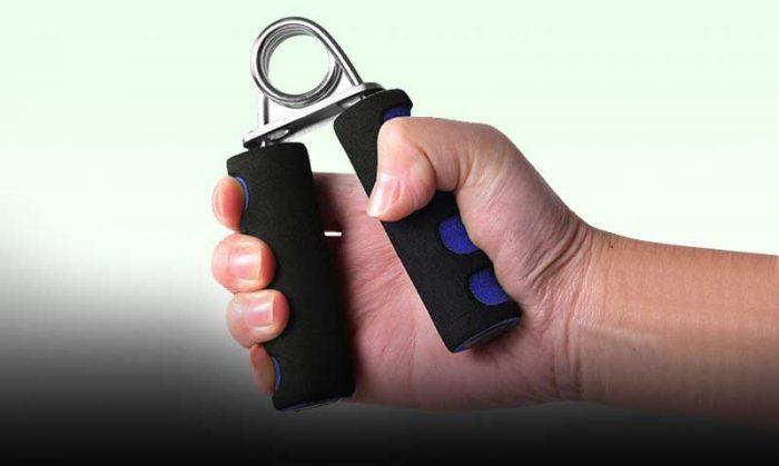 Man squeezing grip strengthener