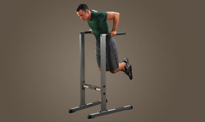 Man doing dips exercise on dip station