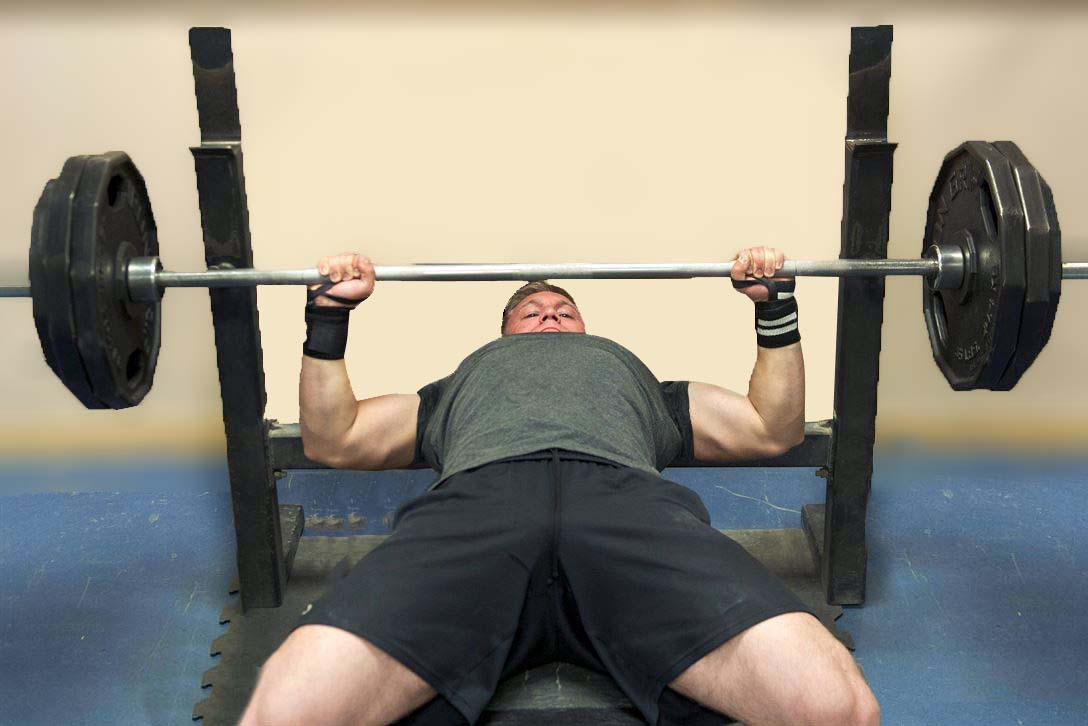Man using bench press rack