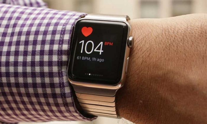 Silver apple watch with heart rate monitor